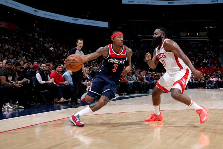 WASHINGTON, DC - OCTOBER 30: Bradley Beal #3 of the Washington Wizards drives to the basket against the Houston Rockets on October 30, 2019 at Capital One Arena in Washington, DC. NOTE TO USER: User expressly acknowledges and agrees that, by downloading and or using this Photograph, user is consenting to the terms and conditions of the Getty Images License Agreement. Mandatory Copyright Notice: Copyright 2019 NBAE (Photo by Stephen Gosling/NBAE via Getty Images)