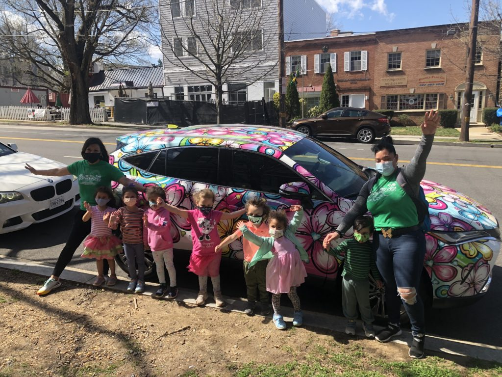 Happy kids in front of the Blossom car