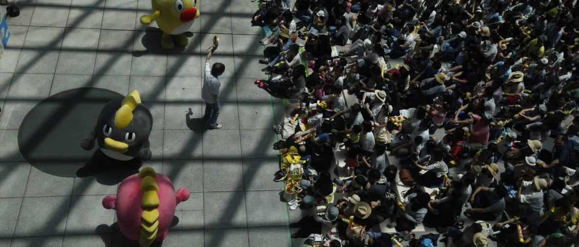 PHOTO BY DAVID GUTTENFELDER, Children and parents gather for an appearance by children's TV characters in Tokyo's Shiodome neighborhood. Through the Lens: Tokyo Transect.